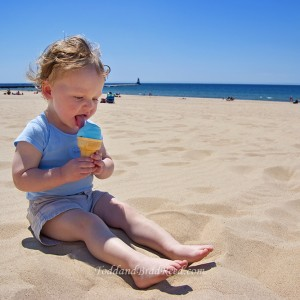 Brad Reed_6494_Ethan eating Blue Moon ice cream on Lud Beach_Darker_square crop_watermarked